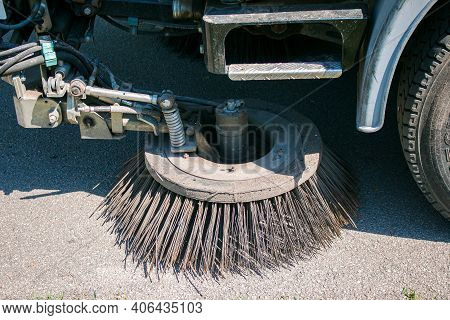 Close-up Sweeper Machine Cleaning. Concept Clean Streets From Debris. Selective Focus.