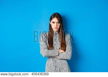 Angry Frowning Woman In Dress, Cross Arms On Chest And Feel Offended About Something Unfair, Standin