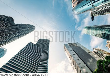 Urban Geometry, Looking Up To The Building. Modern Architecture, Concrete, And Glass. Abstract Archi