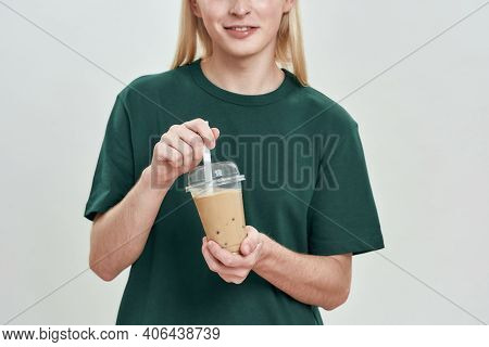 Smiling Young Caucasian Fair Haired Man Holding Cup With Coffee While Posing On Light Background, Cr