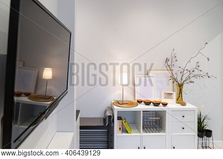 Interior Detail Of A Small Stylish Studio Apartment With A White Cabinet By The White Wall In The Ha
