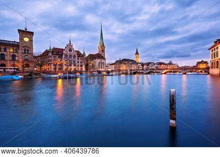 Zurich, Switzerland - March 15, 2014: Fraumunster Church and Church of St. Peter at night, two of the four main churches of Zürich.