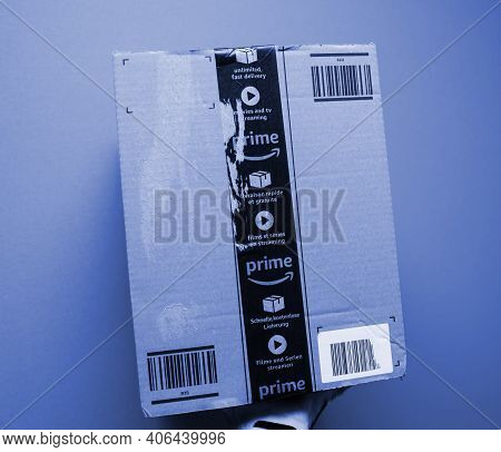 Paris, France - Oct 29, 2018: Pov Male Hand Holding New Package Of Amazon Prime Cardboard Parcel Del