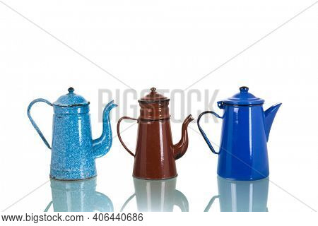 Vintage enamel coffee pots isolated over white background