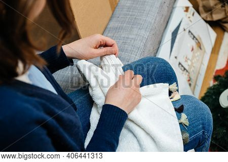 Paris, France - Jan 22, 2021: Side View Of Woman Unboxing New Zara Home Product - Beautiful New Cott