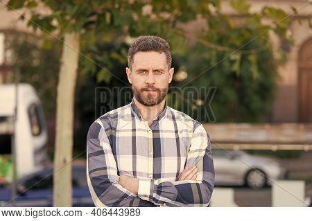 Confident Personality. Man Keep Arms Crossed Outdoors. Handsome Man In Casual Style. Unshaven Man Wi
