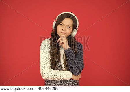 Home Education. Happy Girl Listen Music Red Background. Listening To Melody And Thinking. Study Onli