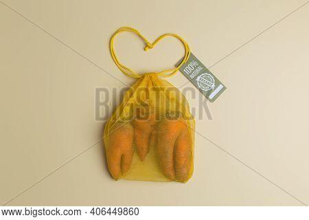 Trendy Ugly Carrots In Yellow Eco Reusable Mesh Bag Creative Concept Zero Waste Shopping