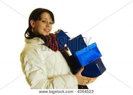 Christmas For Attractive Girl In Her 20S Carryiing A Stack Of Gifts