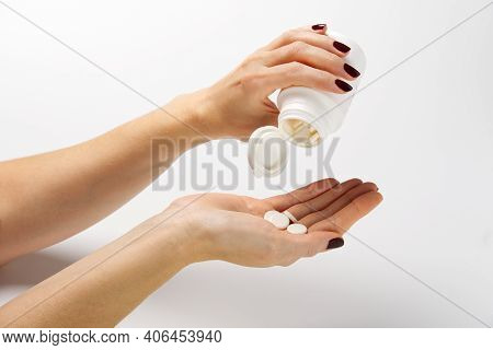 Woman Hand Holding Plastic Jar With White Pills, Taking Vitamins Minerals Drugs
