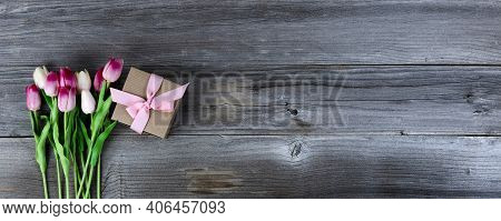 Overhead View Of Pink Tulips And A Giftbox On Rustic Wood For Mothers Day Concept