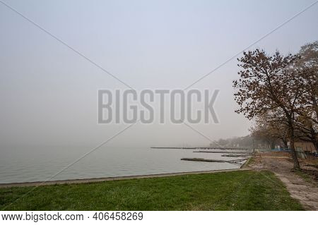 Smoggy Fog In Winter On The Palic Lake, In Subotica, Serbia, With The Quays Visible. Also Known As P