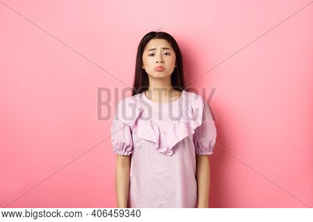 Sad Whining Asian Girl Pouting And Frowning, Looking Upset About Something Unfair, Complaining, Stan
