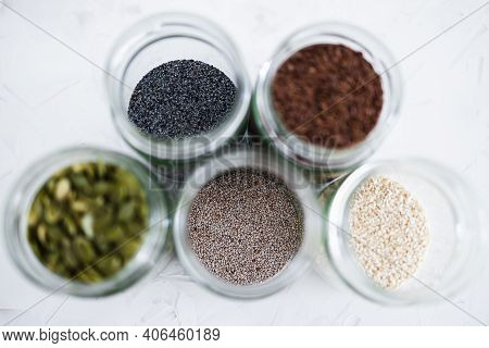 Seed Jars With Sesame Poppy Pupmkin Chia And Flax Seeds As Important Nutrient Sources For Nutrition