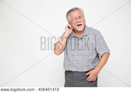Asian Senior Man With Earache Isolated On White Background, Health Problem And Feeling Sick Concept