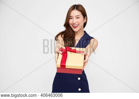 Happy Beautiful Asian Woman Smile With Gold Gift Box Isolated On White Background. Teenage Girls In
