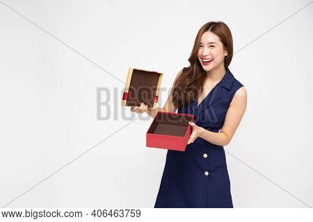 Happy Beautiful Asian Woman Smiling And Open Gold Gift Box Isolated On White Background