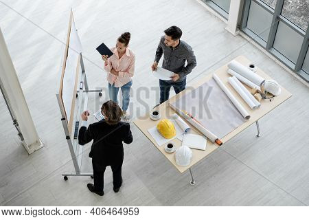 Team Of Male And Female Engineers And Architects, Working Team, Meeting, Discussing Construction And