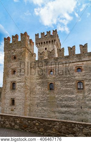 Scaliger Castle Is Historical Landmark Of The City Sirmione In Italy On The Lake Garda. Medieval Ita