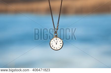 Old Pocket Watch On A Chain Close-up. The Concept Of The Passing Time