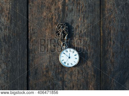 Vintage Pocket Watch Mechanic On Wooden Background, Using As Time Symbol Or Case Deadline Concept.