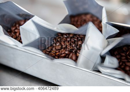 Dark Roasted Coffee Beans In A Plastic Bag