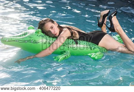 Summer Girl. Beautiful Exotic Woman With Inflatable Crocodile Tanning In Pool. Woman In Swimming Poo