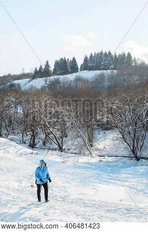 Woman Climbs Snowy Mountain Using Nordic Walking Sticks. Active Lifestyle, Adventure Concept. Nordic
