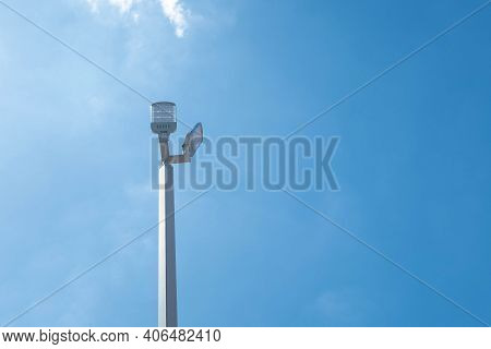 Lamp Post Electricity Industry In Thailand. Electric Pole And Blue Sky.