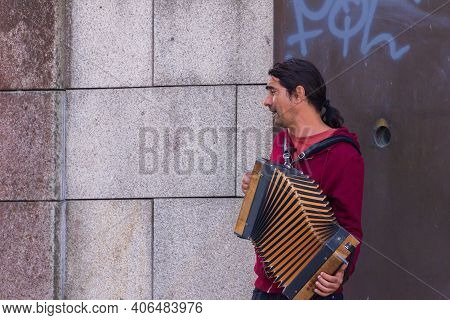 Porto, Portugal, October 06, 2018: Musician Playing On Accordion In The Streets Of Porto.