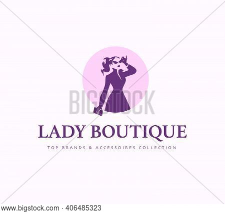 Lady Boutique Logo Design Template Isolated On Light Background. Stylish Lady In Coat With Bag Icon