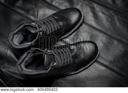 Black Boots Made Of Genuine Leather. Men's Winter Shoes With Laces, Fashionable Style. On A Dark Lea