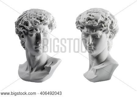 Gypsum Statue Of Davids Head. Michelangelos David Statue Plaster Copy Isolated On White Background.