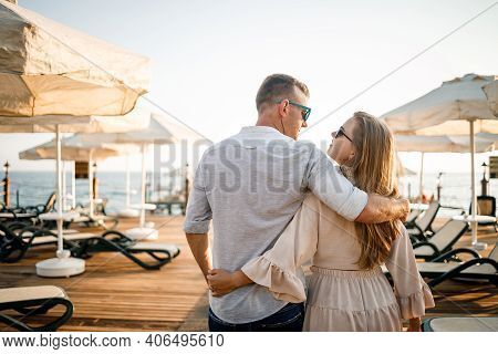 A Loving Couple Is Resting At The Sea In Turkey. Man And Woman On The Pier. Sea Tour. Honeymoon. Cou