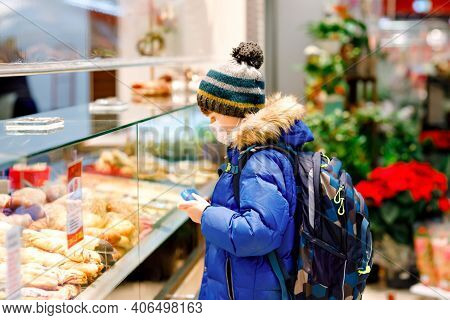 Kid Boy Wearing Medical Mask Buy Bread And Pastry For School Lunch In Bakery. Child With Backpack An