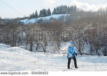 Senior Woman Climbing A Hill Using Nordic Walking Sticks. Active Lifestyle, Adventure Concept. Nordi