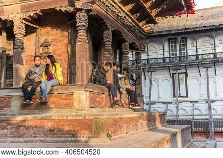 Kathmandu, Nepal - November 13, 2019: Young People Sitting On The Steps Of A Temple At Durbar Square