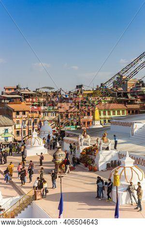 Kathmandu, Nepal - November 14, 2019: People The Great Boudhanath Stupa In Kathmandu, Nepal