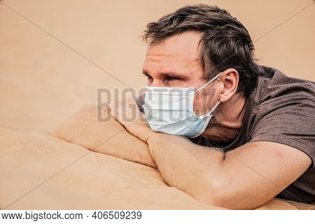 Side Portrait Young Man Wear Protective Mask, Face Expression Emotion. Concept Covid Stress Syndrome