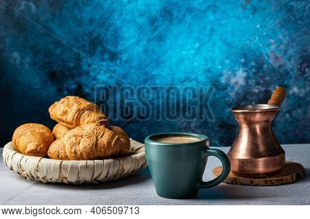 Coffee And Croissants In The Cafe. Serving Coffee With Croissants.