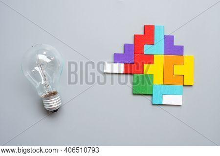 Lightbulb With Colorful Wood Puzzle Piece On Gray Background. New Idea, Creative, Innovation, Imagin