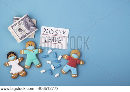 Money, Medicine And A Gingerbread Family In A Mask With The Inscription Paid Sick Leave. Family Medi