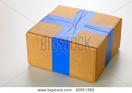 A cardboard box isolated on grey background poster