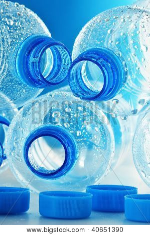 Composition with empty polycarbonate plastic bottles of mineral water poster