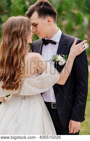 Beautiful, Gentle And Happy Bride And Groom.