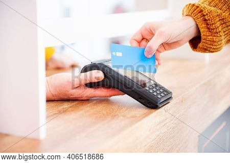 Customer Using Credit Card For Payment To Owner At Shop, Cashless Technology And Credit Card Payment