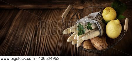 Fresh White Asparagus And Ingredients In A Basket On Rustic Wood. Food Photography With Short Deep O
