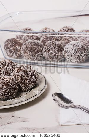 Oats Bonbons On A Plate Whit A Spoon In A White Background