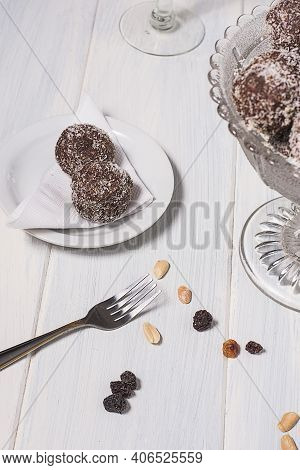Oats Bonbons On A Plate And A Fork In A White Table.