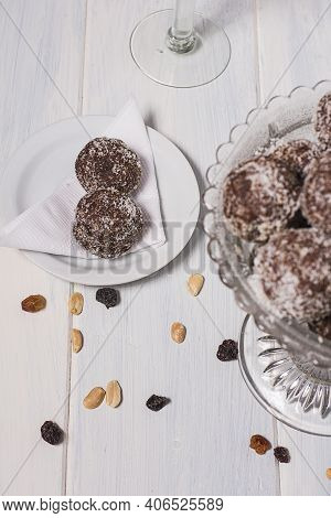Two Oats Bonbons In A Plate In A White Background